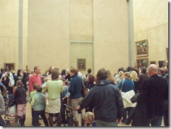 Crowds gawking at the Mona Lisa at the Louvre